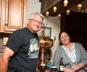 Kurt and Tracy Fichthorn are having fun with the beer kitchen that Kurt long dreamed of installing in the lower level of their home. Between them is a copper/brass keg that friends brought home from Spain and, knowing Kurt would put it to good use, they gave it to the Fichthorns.