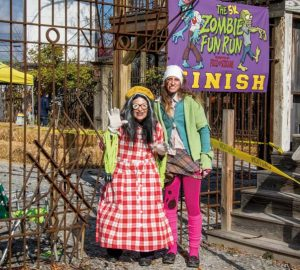 Annette Schopf (left) has played numerous roles at Field of Screams over the years. Here, she and Daisy Wright prepare to distribute medals to finishers in the annual 5K Zombie Run that is held in November and benefits the Pennsylvania Breast Cancer Coalition.