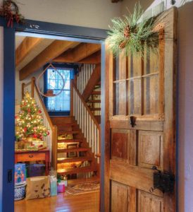 She bought the Indian door that provides access to the master suite from Dwight Graybill of Cocalico Builders. The staircase replicates the one she always admired in her grandparents' house. The floors throughout the house were made from reversed barn boards.