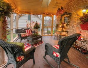 The screened porch is another of Elaine's favorite spaces. She uses it long into fall.
