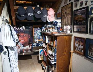 A nook under the staircase is devoted to Elaine's beloved New York Yankees. Favorite memories include attending the game that clinched the 2009 World Series (against the Phillies), the last game played at the old Yankee Stadium, one of the first games played in the new stadium and the game in which Derek Jeter earned his 3,000th hit. She was also in attendance for Derek Jeter Day. Elaine was also a participant in the Yankees' first Women's Mini Fantasy Camp (2011). Apple TV allows her to view all of the Yankees' games.