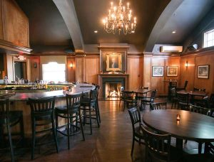 The Tavern Room features a U-shaped bar and seating at various style tables.